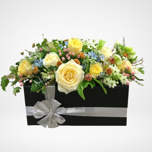 Rose and tweedia flower arrangement