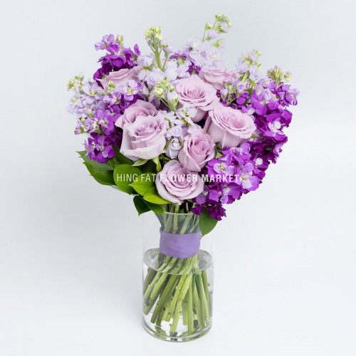 Purple roses & stock with vase