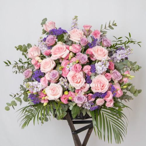 Pink rose and stock flower stand