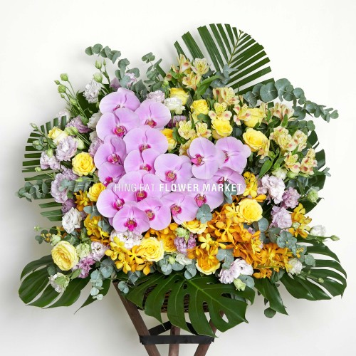 Pink orchid and yellow rose flower stand