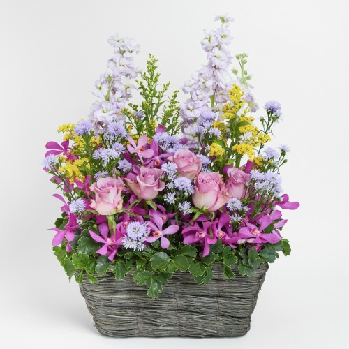 Purple rose and stock flower basket