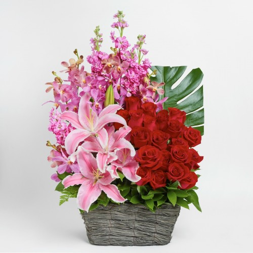 Pink lily and rose flower basket